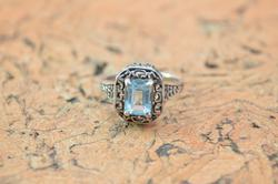 Scroll Detailed Prong Set Blue Stone Ring Size 9 Silver