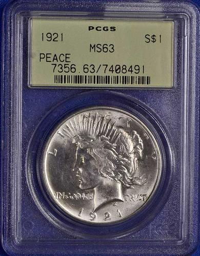Key 1921 High Relief Peace Dollar in an old PCGS MS63 Rattler