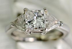 Stunning Platinum Princess-Cut Diamond Trilogy Ring