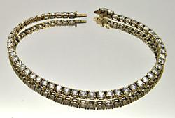 LADIES 14 KT YELLOW GOLD TENNIS BRACELET.