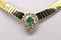 14 KT YELLOW OMEGA NECKLACE WITH EMERALDS AND DIAMONDS