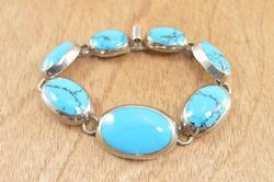 Graduated Bezel Set Blue Stone Link Bracelet Silver