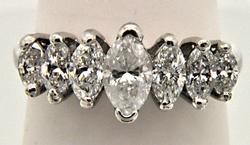 LADIES 14 KT WHITE GOLD DIAMOND PYRAMID RING.