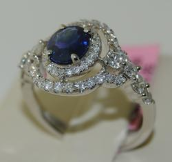 Oval Sapphire in a Lovely Mounting of Diamonds