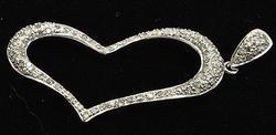 HEART PENDANT WITH DIAMONDS.