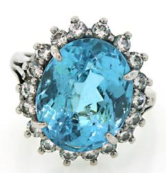 Tempting Blue Topaz & Diamond Halo Ring