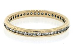 Channel Set Diamond Eternity Band in Yellow Gold