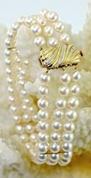 Feminine Triple Strand Pearl Bracelet