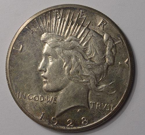 Excellent AU 1928 Peace Silver Dollar
