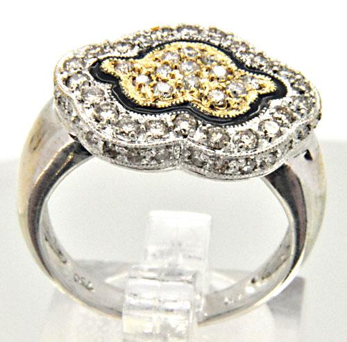 18 KT WHITE AND YELLOW GOLD DIAMOND RING.