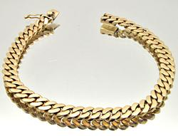 UNISEX 18 KT YELLOW GOLD CURB LINK BRACELET.