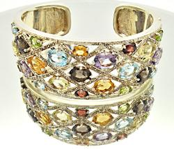 LADIES WIDE MULTI COLOR STONE BANGLE.