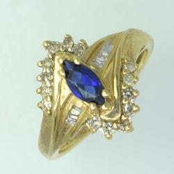 Marquise Cut Blue Sapphire Set in Diamonds and Gold