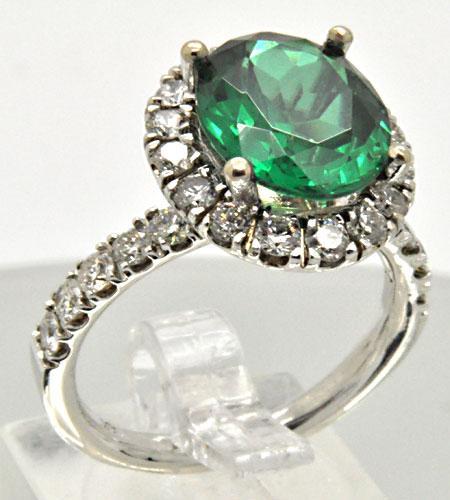 LADIES 14 KT GREEN TOURMALINE 4 DIAMOND RING.