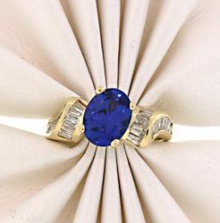Impressive Oval Cut Tanzanite Ring with Diamonds