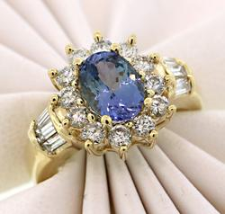 Striking Tanzanite and Diamond Halo Ring