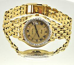 LADIES 14 KT GOLD AND DIAMOND GENEVE WATCH