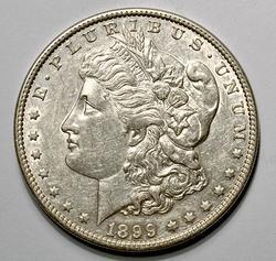 Near UNC 1899 Morgan Silver Dollar