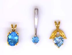 Set of Three Blue Topaz Pendants in Gold