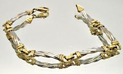 LADIES 14 KT WHITE AND YELLOW GOLD CABLE BRACELET.
