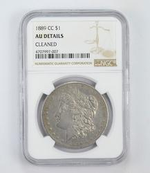 AU Details 1889-CC Morgan Silver Dollar - Cleaned - Graded by NGC