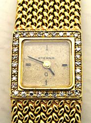 LADIES 18 KT YELLOW GOLD ETERNA DIAMOND WATCH.