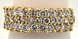 LADIES 14 KT YELLOW GOLD DIAMOND BAND.