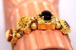 Stunning 14K Gold Bracelet with Four Slide Charms