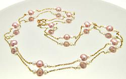 LADIES 14 KT YELLOW GOLD PEARL STATION NECKLACE.