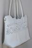 An Elegant Designer Bag By David Jones-Paris