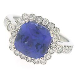 Remarkable Cushion Tanzanite and Diamond Halo Ring