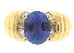 High Quality Oval Tanzanite and Diamond Ring