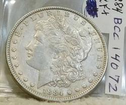 1884 Morgan  Dollar, circulated, original, near Unc