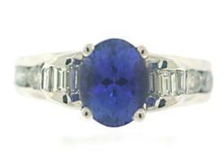 Masterpiece Oval Tanzanite and Channel Set Diamond Ring