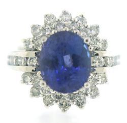 Luxurious Oval Tanzanite and Diamond Halo Ring