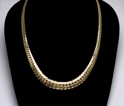 Interesting Grduated Necklace in Gold