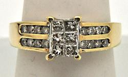 10K YELLOW GOLD LADIES DIAMOND RING.