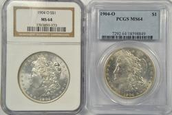 2 Near Gem BU 1904-O Morgan Dollars. NGC & PCGS MS64