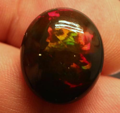 Ravishing 9.54ct play of color Black Opal