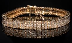 Breathtaking 13.76CTW Diamond Bracelet in 14KT Gold