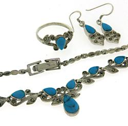 Set of Turquoise Necklace. Earrings and Ring