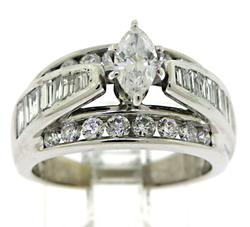 Round Brilliant Cut and Baguette Shank Diamond Ring