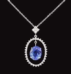 14KT White Gold Tanzanite & Diamond Pendant and Chain