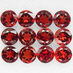 Ravishing ruby red 11.82ct 6mm Garnet set