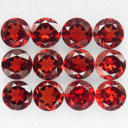 Ravishing ruby red 11.82ct 6mm Garnet set
