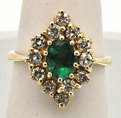 14 KT YELLOW GOLD EMERALD AND DIAMOND RING.