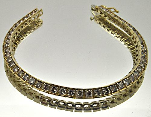 LADIES 14 KT YELLOW GOLD DIAMOND BRACELET.