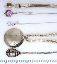Lot of Five - Four Pendants on Chains & One Bracelet