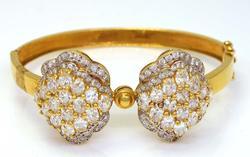 Spectacular 18K Gold Bow Motif Hinged Bangle