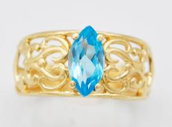 Beautiful Blue Topaz & Solid Gold Cocktail Band